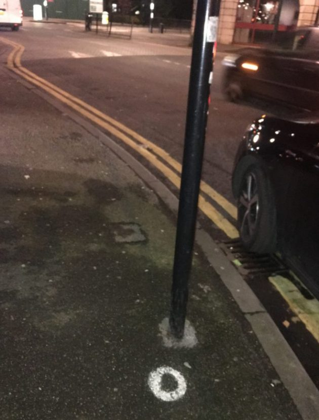 The white ring on the pavement marks a particularly pointless spot for a planned parking sign